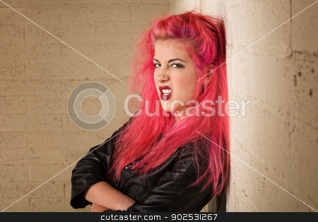 Mad Young Woman stock photo, Sneering young female with folded arms against the wall by Scott Griessel