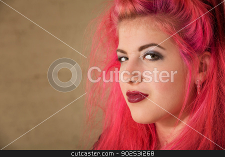 Conceited Punk Teen stock photo, Conceited teenage female with pink hair close up by Scott Griessel