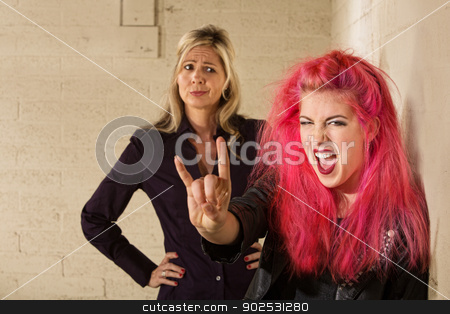 Teen with Doubting Adult stock photo, Teenager in pink hair with disapproving mother in background by Scott Griessel
