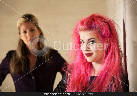 Cute Girl and Concerned Parent stock photo, Cute smiling teenager with concerned parent in background by Scott Griessel