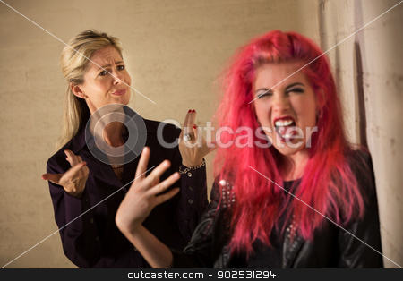 Disapproving Mother stock photo, Loud teenage girl in pink hair with disapproving mother by Scott Griessel