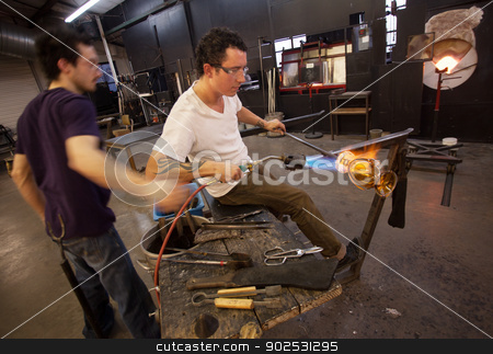 Glass Workers Using Blowtorch stock photo, Two glass artists working together with blowtorch by Scott Griessel