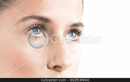 Beauty face close up stock photo, Woman Blue Eyes close up Looking up with white Background by ABBPhoto