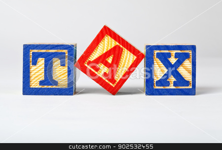 TAX Bricks stock photo, Letter bricks spelling out TAX by Chris Dorney