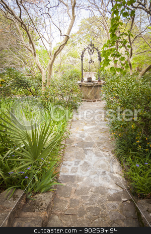 Beautiful Lush Park Walkway and Antique Well stock photo, Beautiful Lush Park Walkway and Antique Well with a Variety of Foliage. by Andy Dean