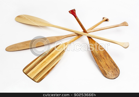 wooden canoe paddles stock photo, wooden canoe paddles of different shapes and sizes including a classic beaver tail on white background by Marek Uliasz