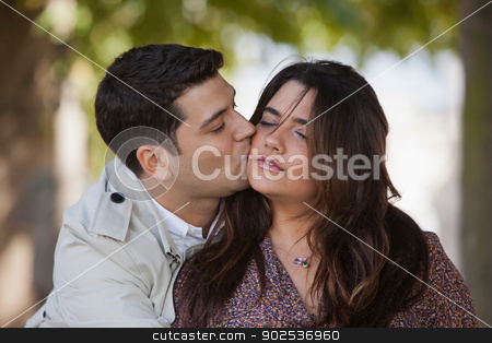Monica-9235.jpg stock photo, Close-up of a couple romancing in the park by Gabriela Medina