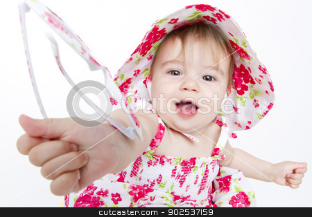 Sharing is Caring stock photo, Little baby girl with pretty red flower dress and hat handing over her sun glasses to you. by Ozgur Coskun