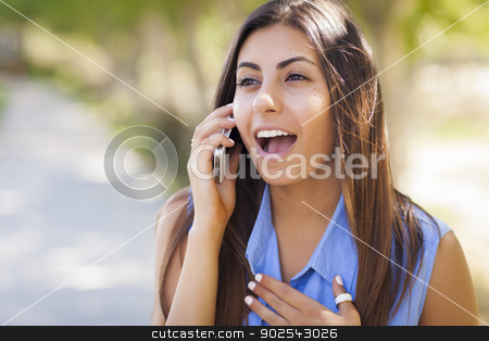 Mixed Race Young Adult Woman Using Her Cell Phone stock photo, Smiling Mixed Race Young Adult Woman Using Her Cell Phone Outside. by Andy Dean