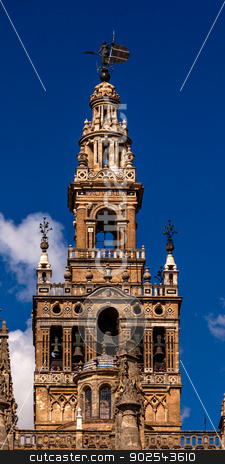 Giralda Bell Tower Cathedral of Saint Mary of the See Spire Weat stock photo, Giralda Spire, Bell Tower, Seville Cathedral, Cathedral of Saint Mary of the See, Seville, Andalusia Spain.  Built in the 1500s.  Largest Gothic Cathedral in the World and Third Largest Church in the World.  Burial Place of Christopher Columbus.  Giralda is a former minaret converted into a bell tower by William Perry