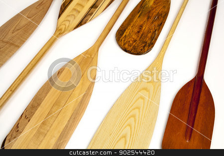 canoe paddle abstract stock photo, blades of wooden canoe paddles, different shapes and sizes,  on white background by Marek Uliasz