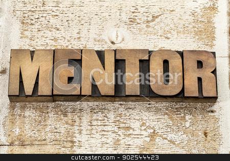 mentor word in wood type stock photo, mentor word in vintage letterpress wood type blocks against grunge white painted barn wood by Marek Uliasz
