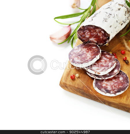 traditional sliced meat sausage salami on wooden board stock photo, Close-up traditional sliced meat sausage salami on wooden board by klenova