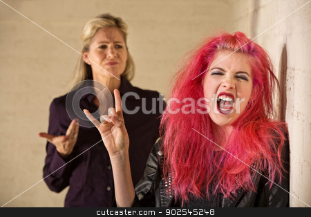 Sneering Parent and Loud Daughter stock photo, Angry parent with loud teenager with pink hair by Scott Griessel