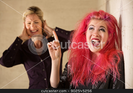 Annoying Teen Singing stock photo, Woman covering ears while woman in pink hair sings by Scott Griessel