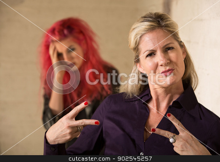 Embarrassed Teen with Mother stock photo, Cool mother making hand gesture with embarrassed teenager by Scott Griessel