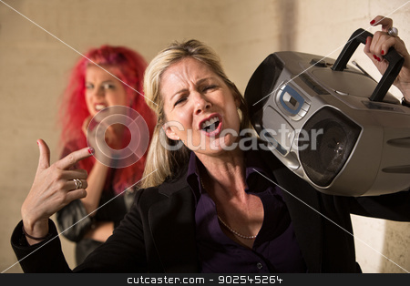 Loud Parent with Radio stock photo, Loud mature woman with radio and cringing teenager by Scott Griessel