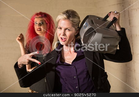 Poser Mother with Teen stock photo, Silly mature European woman playing radio near startled teenager by Scott Griessel