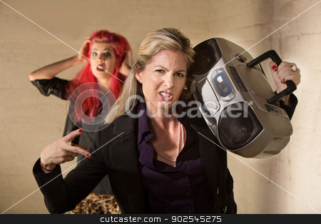 Awkward Woman with Boom Box stock photo, Awkward funny woman with radio and embarrassed teenager by Scott Griessel