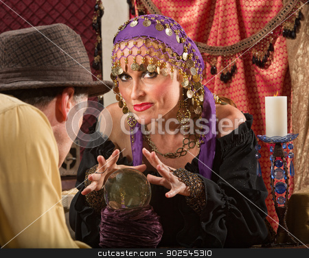 Fortune Teller Waving Hands stock photo, Sexy fortune teller waving hands over crystal ball by Scott Griessel