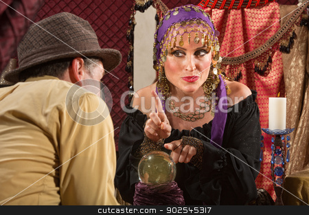 Gypsy Fortune Teller stock photo, Pretty gypsy lady pointing with finger over crystal ball by Scott Griessel