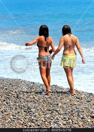 Summer vacation. stock photo, Teens on summer vacation walking on the beach. by OSCAR Williams