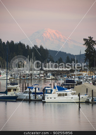 Mt Rainier Yachts Boats and Buildings Gig Harbor Washington USA stock photo, The sleepy harbor of the town of Gig Harbor with Mt Rainier catching the light from sunset in the background by Christopher Boswell