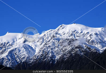 Snow covered mountains stock photo, Snow covered mountains near Franz Josef glacier New Zealand by Bonnie Fink
