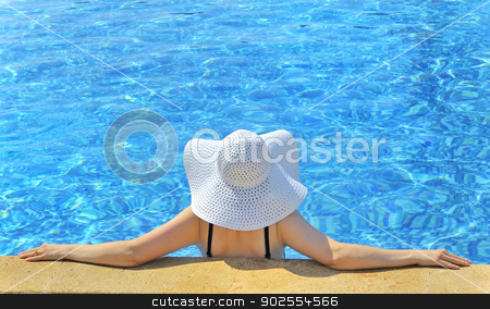 Woman with  hat relaxing  stock photo, Woman with  hat relaxing on swimming pool by Iordache Magdalena