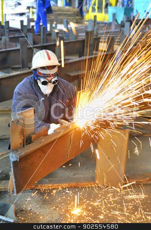 worker using torch cutter to cut through metal stock photo, worker using torch cutter to cut through metal in factory by Iordache Magdalena