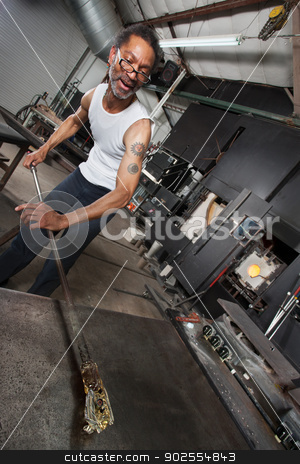 Man Creating Glass Art stock photo, Busy African glass factory owner creating art object by Scott Griessel