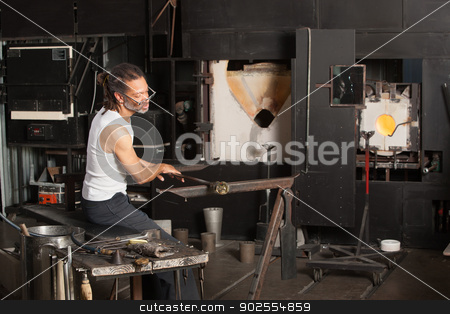 Male Working on Fine Art Glass stock photo, Mature male sitting near blast furnace with fine art glass by Scott Griessel