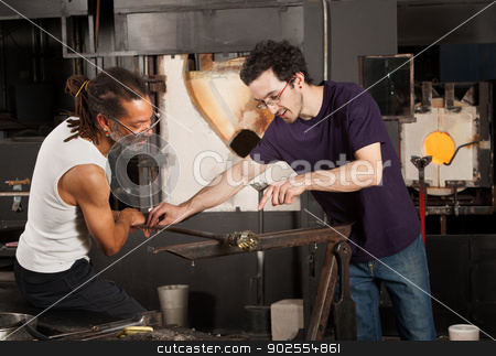 Two Glass Artisans at Work stock photo, Two glass artisans working together on small vase by Scott Griessel