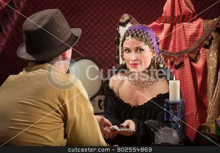 Fortune Teller with Businessman stock photo, Sexy fortune teller with businessman and candle by Scott Griessel