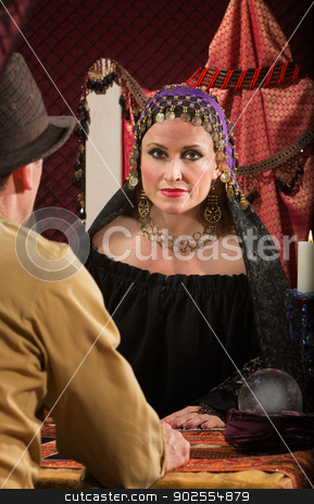 Romani Woman with Man stock photo, Calm romani female with crystal ball and man by Scott Griessel
