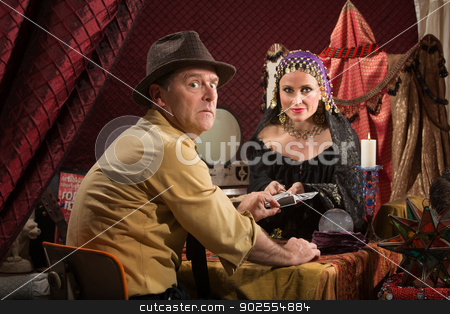 Cursed Man with Fortune Teller stock photo, Man with fortune teller worried about bad luck by Scott Griessel