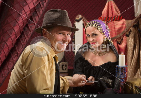 Lucky Man with Fortune Teller stock photo, Lucky businessman taking tarot card from fortune teller by Scott Griessel