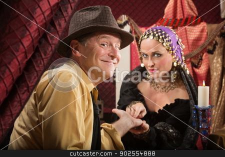 Palm Reader with Happy Man stock photo, Relieved European man with beautiful palm reader by Scott Griessel