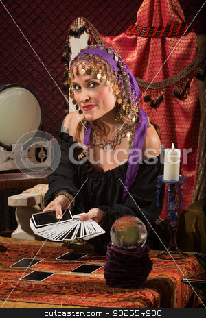 Pretty Roma Fortune Teller stock photo, Beautiful Roma woman with crystal ball and tarot cards by Scott Griessel