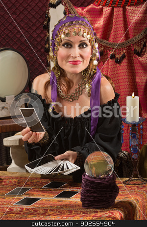 Charming Tarot Card Lady stock photo, Charming sexy European tarot card reader in headscarf by Scott Griessel