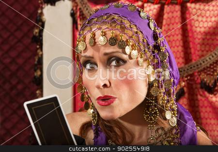 Worried Fortune Teller stock photo, Worried European gypsy fortune teller with tarot card by Scott Griessel