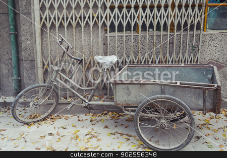 Weathered Bike Parked in Beijing  stock photo, Weathered Bike Parked on sidewalk in Beijing, China by Bryan Mullennix
