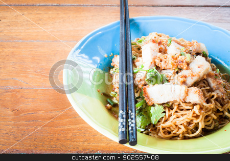Stir fried spicy noodles with crispy pork and chopstick stock photo, Stir fried spicy noodles with crispy pork and chopstick by punsayaporn