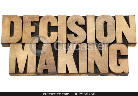 decision making stock photo, decision making - isolated text in letterpress wood type printing blocks by Marek Uliasz