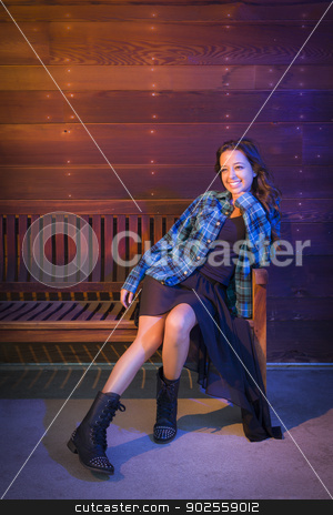 Mixed Race Young Adult Woman Portrait Sitting on Wood Bench stock photo, Portrait of a Pretty Mixed Race Young Adult Woman Sitting on Wooden Bench Against a Lustrous Wood Wall Background. by Andy Dean