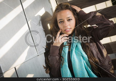 Mixed Race Young Adult Woman Against a Wood and Metal Wall stock photo, Portrait of a Pretty Mixed Race Young Adult Woman Against a Wood and Metal Wall Background. by Andy Dean