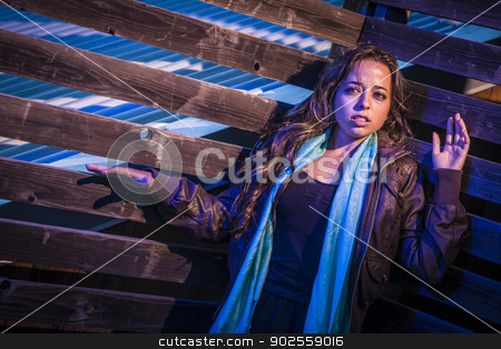 Frightened Pretty Young Woman in Dark Walkway at Night stock photo, Frightened Pretty Young Woman in Dark Scary Walkway at Night. by Andy Dean