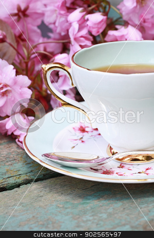 Beautiful japanese cherry tree and a cup of tea stock photo, Beautiful japanese cherry tree and a cup of tea on the old table by Juliet Photography