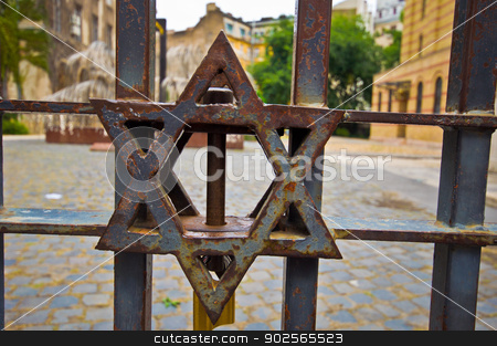 Star of David stock photo, old and rusty Star of of David at the synagogue in Budapest by Juliane Jacobs