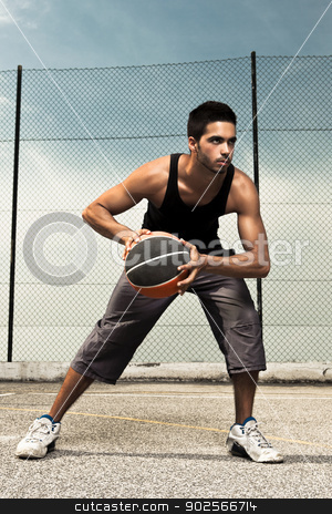 Basket Player stock photo, Portrait of young man street basket player by ikostudio